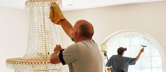 Cleaning chandeliers and high windows. Photo/source: Window Care, Inc.