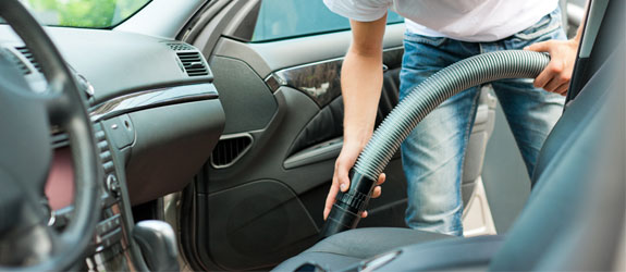 Cleaning the inside of a car with vacuum